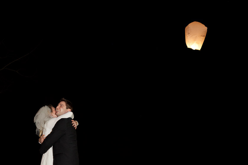 releasing paper hot air lanterns at wedding floating dreams | abby+erik